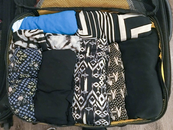 Next travel packing hack: keep clothes color-coordinated and roll them inside the packing cube