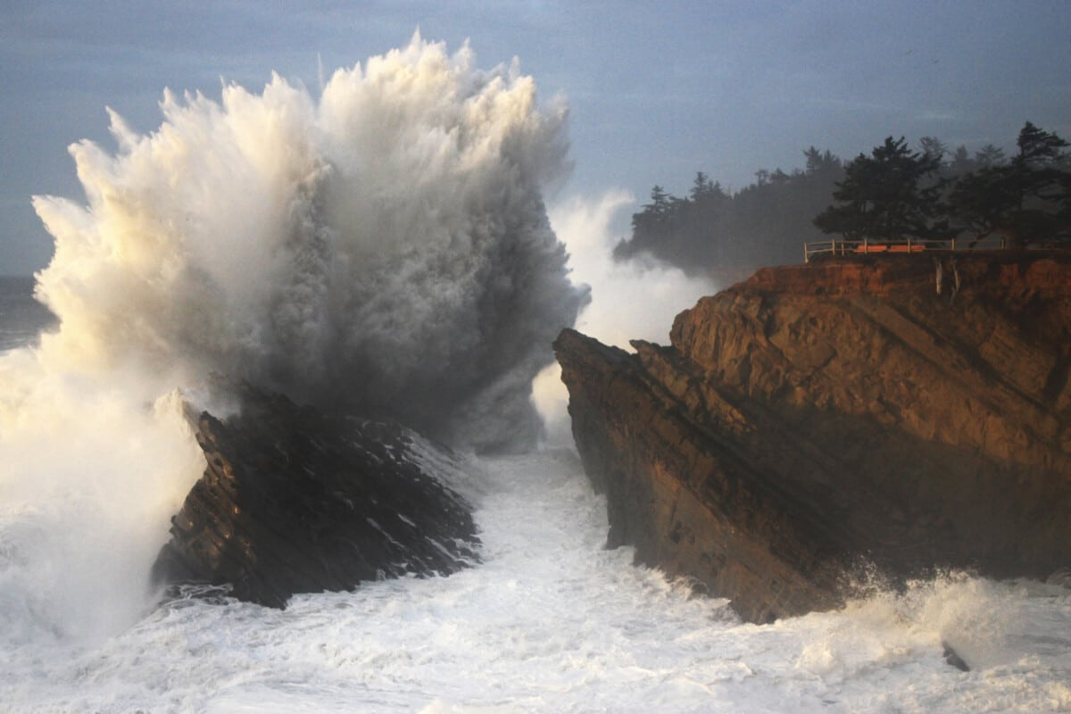 Watching dramatic waves break at Shore Acres Stat Park is an exhilarating thing to do at Coos Bay.