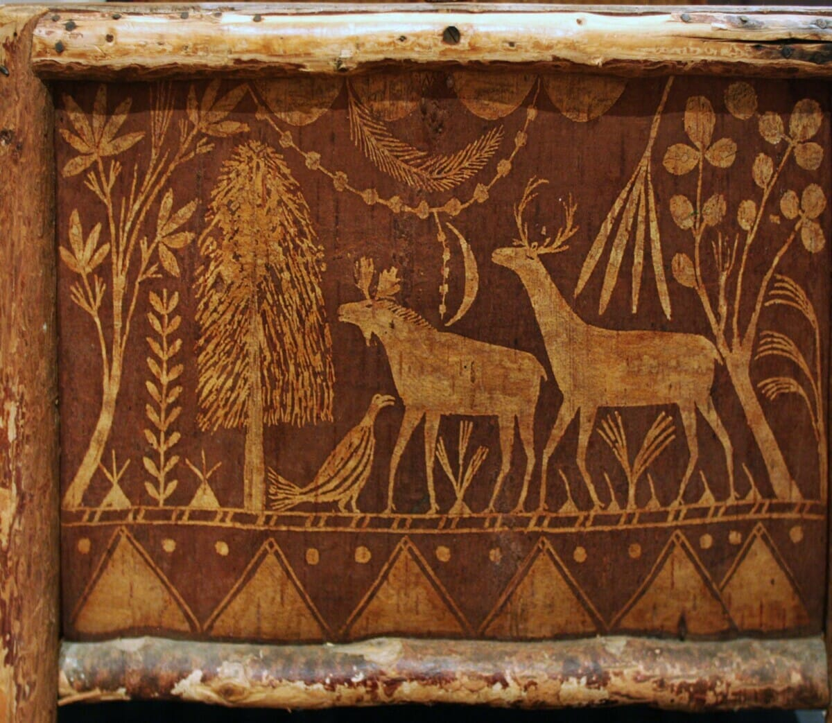 rustic carving of plants and animals
